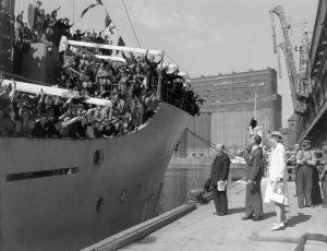Netherlands Ambassador Dr. J.H. van Roijin and Mrs. van Roijin greeting Dutch immigrants arriving by ship in Montreal, June 1947